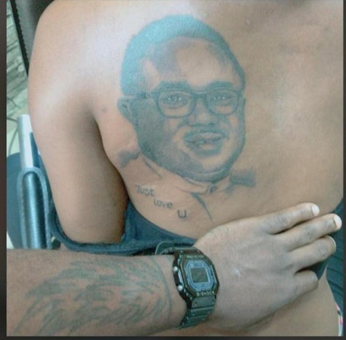 Just Love U - Lady tattoos the face of Cross River State Governor, Ben Ayade to her back (Photo)